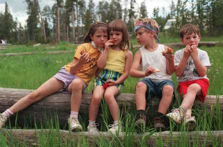 The kids eat lunch.  Yellowstone 7/98