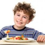 Boy eating pasta